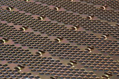 Metal surface with holes Royalty Free Stock Photography