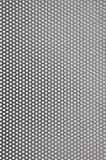 Metal surface with holes. Industrial background Stock Photo