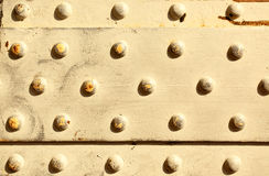 Metal surface with rivets Royalty Free Stock Photo