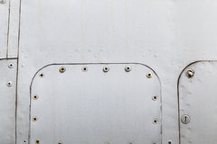 Metal surface with rivets Royalty Free Stock Photography