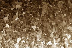 Metal surface with scratches in brown tone. Stock Image