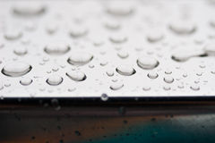 Metal surface wet. Metal reflexive surface with several rain droplets stock photos