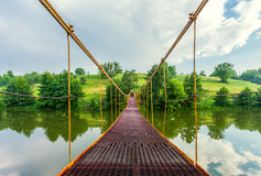 Metal suspension bridge Royalty Free Stock Images