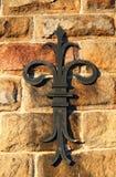 Metal symbol. Metal rosette symbol on the brick wall royalty free stock photos