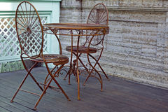 Metal table and chair in street Royalty Free Stock Photo