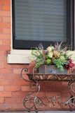 Metal table with Fall arrangement set on old porch Stock Photography