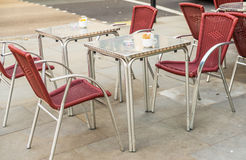 Metal tables and wicker chairs, restaurant front, restaurant gar royalty free stock image