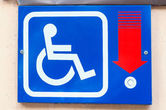 Metal tablet with signal button for the disabled people on the building wall Royalty Free Stock Photos