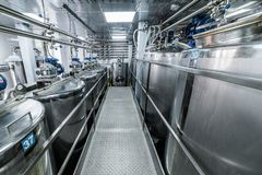 Metal tanks, modern production of alcoholic beverages. Food industry stock image