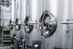 Metal tanks, modern production of alcoholic beverages. royalty free stock image