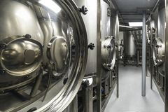 Metal tanks, modern production of alcoholic beverages. stock image