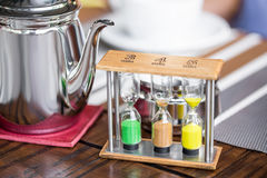Metal teapot with a sandglass Royalty Free Stock Photo