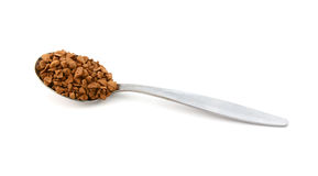 Metal teaspoon measure of instant coffee granules Royalty Free Stock Photos