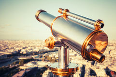 Metal telescope on Eiffel Tower, Paris. Retro stylized photo. Shining metal telescope mounted on the railings of Eiffel Tower, Paris. Retro stylized vintage Stock Images