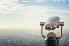 A metal telescope viewfinder overlooking Los Angeles, California. A metal telescope viewfinder mounted on a Hollywood Hill in Los Angeles, California royalty free stock image