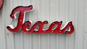 Metal Texas sign hangin on wall Royalty Free Stock Images