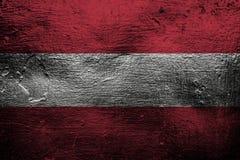 Metal a textura ou o fundo com mistura da bandeira de Áustria Imagens de Stock Royalty Free