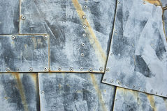Metal texture. Made of rusty patches with rivets stock photos