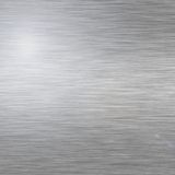 Metal texture. Brushed Metal texture with lighting and lens ghost stock photos