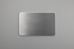 Metal texture abstract background with a plate Royalty Free Stock Photography