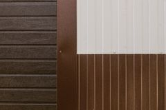 Metal texture brown and white siding. Close Stock Photo