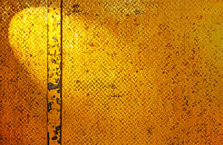Metal texture. Close up of yellow metal texture plate with rhombus shape Royalty Free Stock Photography