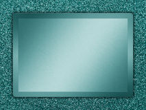Metal Texture. Cyan colored metallic plate on a cyan background Stock Photography