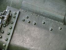 Metal texture with elements of rivets, welds and abrasions on surface Stock Photos