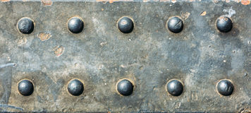 Metal Texture. Grunge background metal plate with screws Stock Image