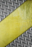 Metal texture on grunge yellow cement wall. Stock Image