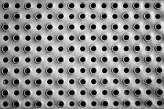 Metal texture with holes. For background Royalty Free Stock Photos