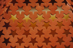Metal texture with holes in the form of stars Stock Photography