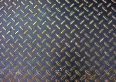 Metal texture. Iron floor surface photo. Metal relief for walking path in construction area. Royalty Free Stock Photos