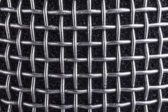 Metal texture microphone. Metal microphone Grille, close up background macro image stock image