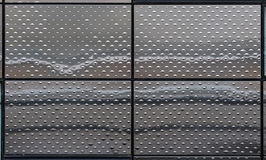Metal texture on a modern building. Panels of shiny metal with a regular pattern of bumps stock illustration