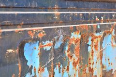 Metal  texture. Peeling paint blue rusty textured metal background Royalty Free Stock Images