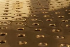 Metal texture. metal perforated texture with a golden hue royalty free stock image