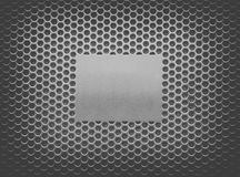 Metal texture plate on steel mesh Royalty Free Stock Photo