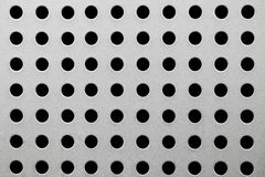 Metal texture with round holes Stock Photo