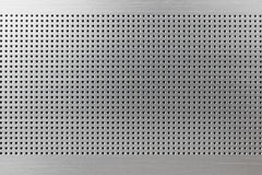 Metal texture with small holes Royalty Free Stock Images