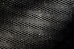 Metal Texture. With small rounded wholes and pattern shapes royalty free stock photography