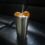 Metal thermos with snacks on black background texture Royalty Free Stock Image