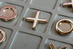 Metal tic tac toe board. Close up of a metal tic tac toe board Stock Photos