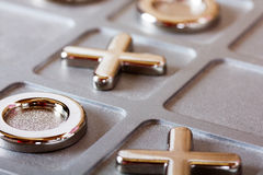 Metal tic tac toe board. Close up of a metal tic tac toe board Royalty Free Stock Photography