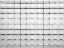 Metal tiled relief panels at the wall Royalty Free Stock Image