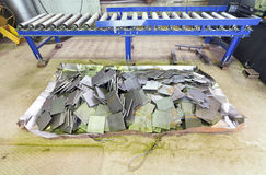 Metal tiles and roll feeder conveyor Royalty Free Stock Image