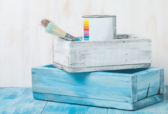 Metal tin can with paint and brush. In wooden box Royalty Free Stock Photos