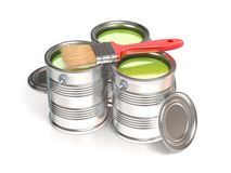 Metal tin cans with green paint and paintbrush Stock Photos