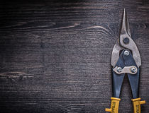 Metal tin snips on wooden board copyspace Royalty Free Stock Photography