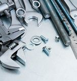 Metal tools and fixing elements on the scratched Stock Image